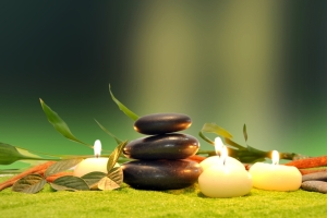 green leaf with natural water drops candles with colored stones